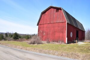 Red barn against a blue sky on Fox Hill Rd