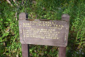 Sign post at Huyck Rd